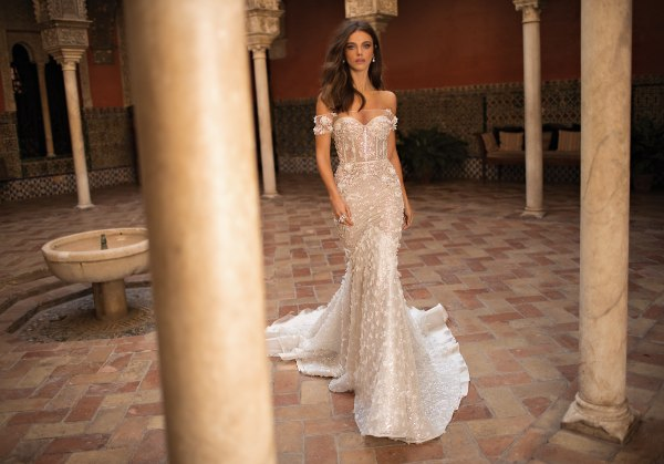 Sheer trumpet wedding dress with off the shoulder sweetheart neckline and floral appliques